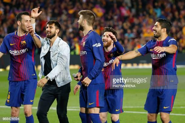 Barcelona's Spanish midfielder Sergio Busquets Barcelona's Portuguese midfielder Andre Gomes Barcelona's Spanish defender Gerard Pique Barcelona's...