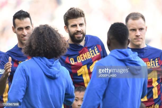Barcelona's Spanish midfielder Sergio Busquets Barcelona's Spanish defender Gerard Pique and Barcelona's German goalkeeper MarcAndre Ter Stegen wear...