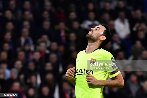 Barcelona's Spanish midfielder Sergio Busquets reacts during the UEFA Champions League round of 16 first leg football match between Lyon and FC...