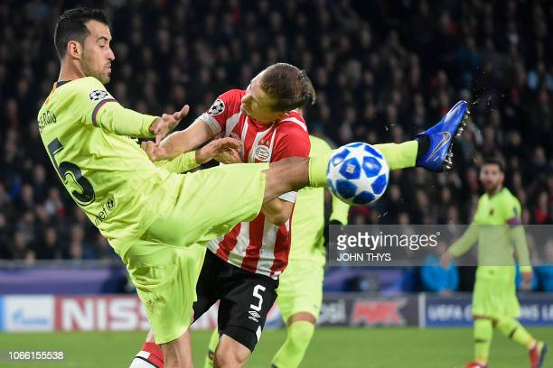 Barcelona's Spanish midfielder Sergio Busquets vies with Eindhoven's defender Daniel Schwaab during the UEFA Champions League football match between...