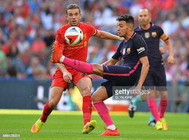 Barcelona's Spanish striker Munir El Haddadi vies with Liverpool's English midfielder Jordan Henderson during the preseason International Champions...
