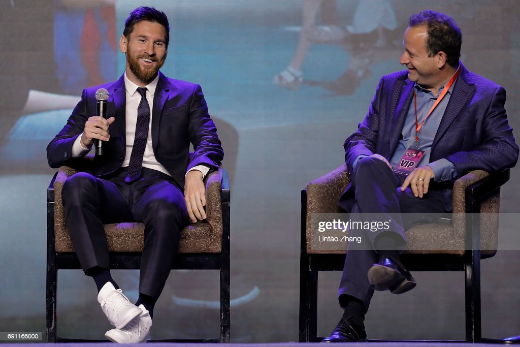 FC Barcelona's striker Lionel Messi (L) with Mediapro Exibtions CEO David Xirau (R) attend the a news conference at China World Trade Center Grand Hotel on June 1, 2017 in Beijing, China. Messi arrived in China to attend an event related to the Messi soccer Eco Experience Pavilion. The park is to be build in Nanjing and will be the largest theme park in the world.