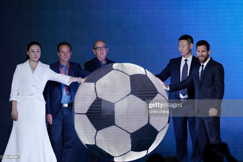 FC Barcelona's striker Lionel Messi (R) with Zhang Wei attend the a news conference at China World Trade Center Grand Hotel on June 1, 2017 in Beijing, China. Messi arrived in China to attend an event related to the Messi soccer Eco Experience Pavilion. The park is to be build in Nanjing and will be the largest theme park in the world.
