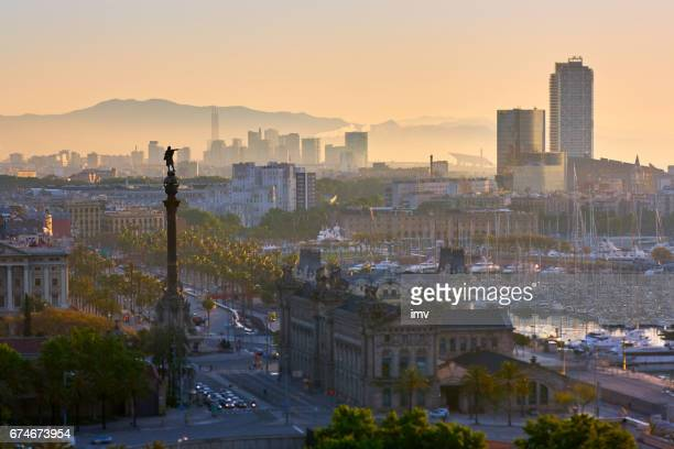 barcelona's sunrise a clear day - colon stock photos and pictures
