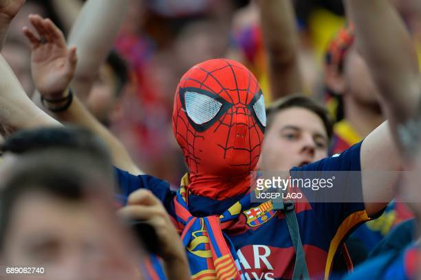 A Barcelona's supporter sporting a Spiderman mask gestures before the Spanish Copa del Rey final football match FC Barcelona vs Deportivo Alaves at...