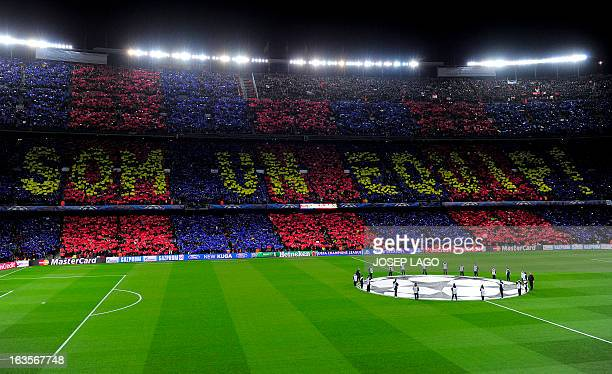 Barcelona's supporters cheer on their team before the UEFA Champions League round of 16 second leg football match FC Barcelona against AC Milan at...