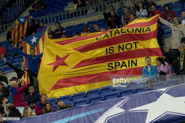 Barcelona's supporters hold independence flags during the UEFA Champions League match between FC Barcelona and Olympiacos FC in Barcelona on October...