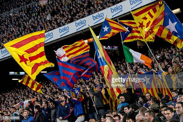 Barcelona Catalonia Spain December 30 Barcelona's supporters holds proindependence flags during the spanish football league between FC Barcelona and...