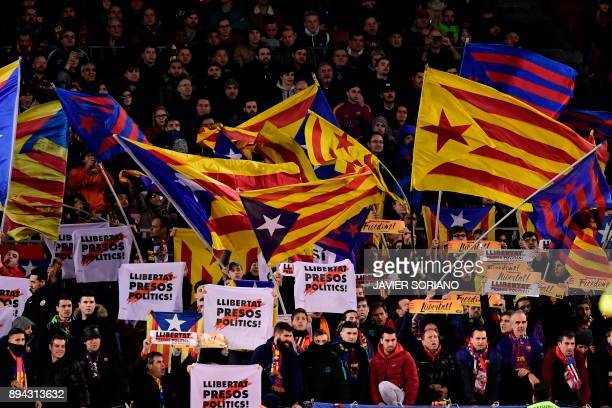 Barcelona's supporters wave a Catalan proindependence 'Estelada' flags during the Spanish league football match FC Barcelona against RC Deportivo de...