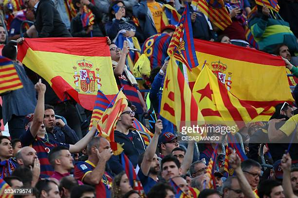 Barcelona's supporters wave Spanish flag and proindependence Catalan flags 'estelada' the Spanish 'Copa del Rey' final match FC Barcelona vs Sevilla...