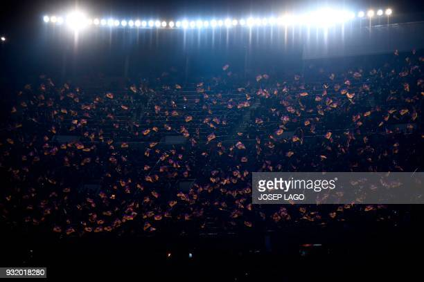 Barcelona's supporters wave the club's flags during the UEFA Champions League round of sixteen second leg football match between FC Barcelona and...