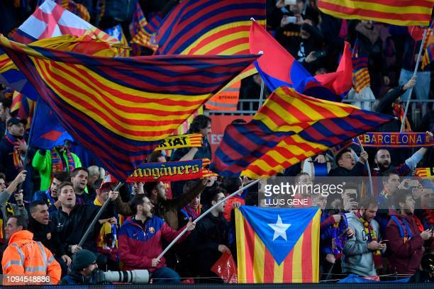 Barcelona's supporters wave their team's flags and Catalan proindependence Estelada flags during the Spanish Copa del Rey semifinal first leg...