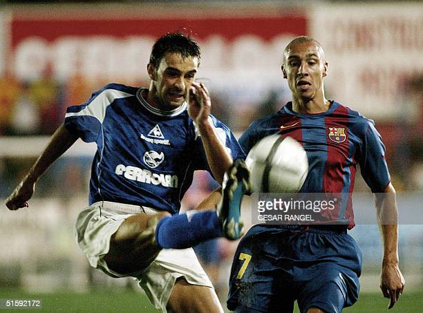 Barcelona's Swede Larsson vies with Gramanet's Pons during a King Cup soccer match in Barcelona 27 October 2004 AFP PHOTO/CESAR RANGEL