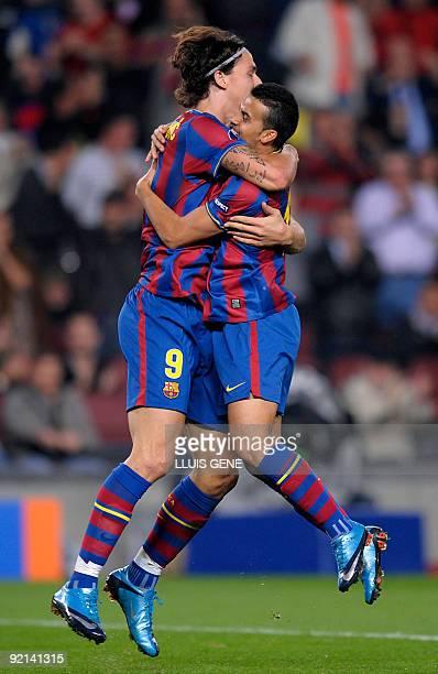 Barcelona's Swedish forward Zlatan Ibrahimovic celebrates with teammate forward Pedro Rodriguez after scoring during the UEFA Champions League...
