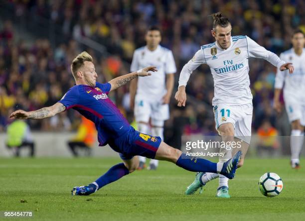 Barcelona's Swiss midfielder Ivan Rakitic vies with Real Madrid forward Gareth Bale during the Spanish league football match between FC Barcelona and...