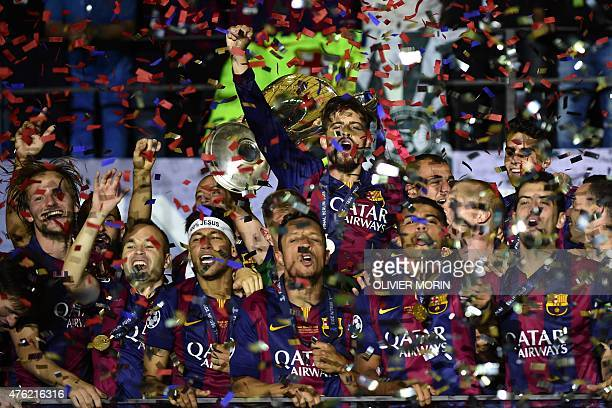 Barcelona's team celebrates with the trophy after winning the UEFA Champions League Final football match between Juventus and FC Barcelona at the...