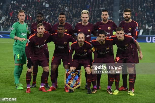 Barcelona's team players Barcelona's German goalkeeper MarcAndre Ter Stegen Barcelona's French defender Samuel Umtiti Barcelona's Brazilian...