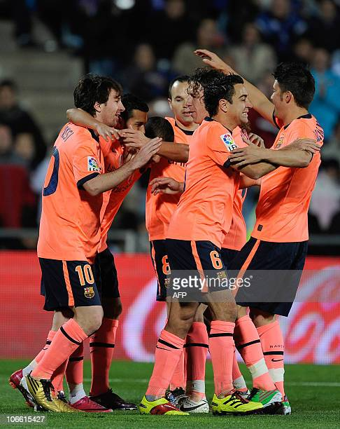 Barcelona's Teammates celebrate after Barcelona's forward Pedro Rodriguez scored against Getafe during their Spanish League football match at Alfonso...