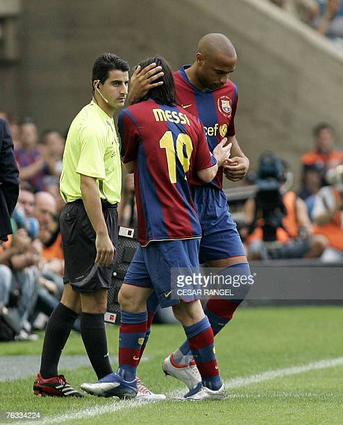 Barcelona's Thierry Daniel Henry enters to play and replaces Argentinian Leo during their Spanish League football match against Racing at the...