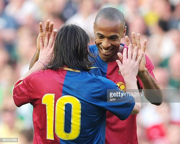 Barcelona's Thierry Henry and Lionel Messi celebrate the second goal of a friendly football match against Scotland's Hibernian FC at Murrayfield...