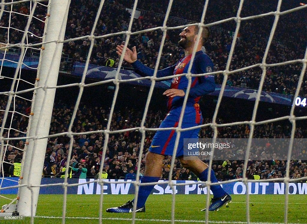Barcelona's Turkish forward Arda Turan celebrates after scoring during the UEFA Champions League Group C football match FC Barcelona vs Borussia Moenchengladbach at the Camp Nou stadium in Barcelona, on December 6, 2016. / AFP / LLUIS