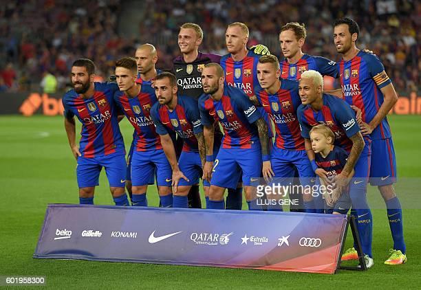Barcelona's Turkish midfielder Arda Turan Barcelona's midfielder Denis Suarez Barcelona's Argentinian defender Javier Mascherano Barcelona's forward...