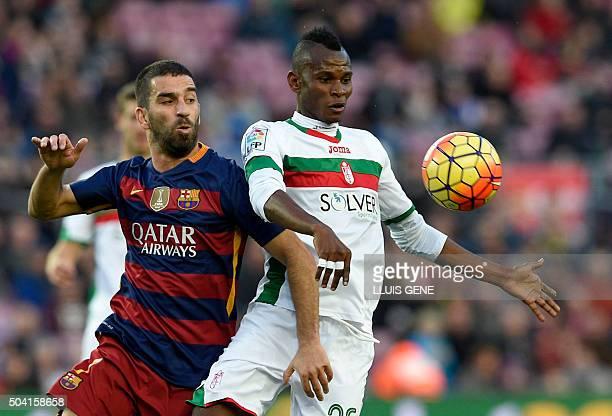 Barcelona's Turkish midfielder Arda Turan vies with Granada's Nigerian midfielder Uche during the Spanish league football match FC Barcelona vs...