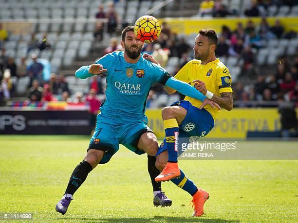 Barcelona's Turkish midfielder Arda Turan vies with Las Palmas' midfielder Momo during the Spanish league football match UD Las Palmas vs FC...