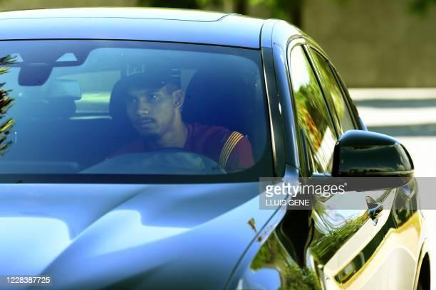 Barcelona's Uruguayan defender Ronald Araujo arrives at the Joan Gamper Ciutat Esportiva in Sant Joan Despi near Barcelona for a training session on...