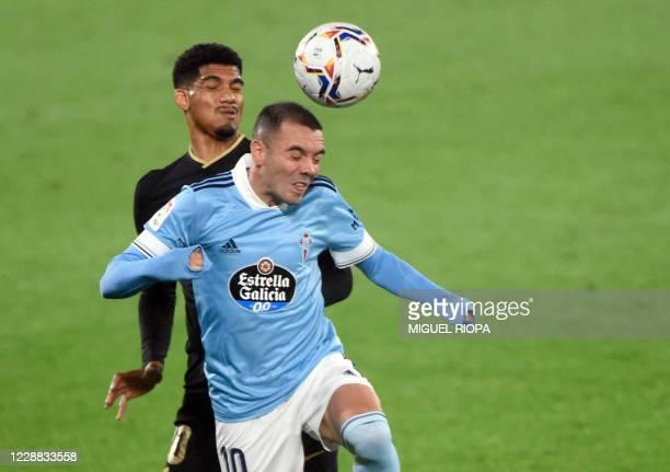 Barcelona's Uruguayan defender Ronald Araujo vies with Celta Vigo's Spanish forward Iago Aspas during the Spanish league football match RC Celta de...