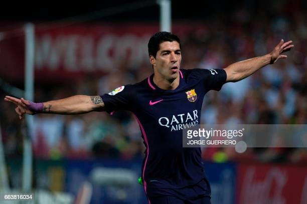 Barcelona's Uruguayan forward Luis Alberto Suarez celebrates after scoring during the Spanish league football match Granada FC vs FC Barcelona at...