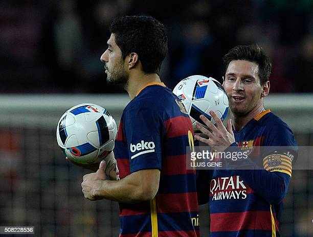 Barcelona's Uruguayan forward Luis Suarez and Barcelona's Argentinian forward Lionel Messi leave the pitch after they made it a hattrick during the...