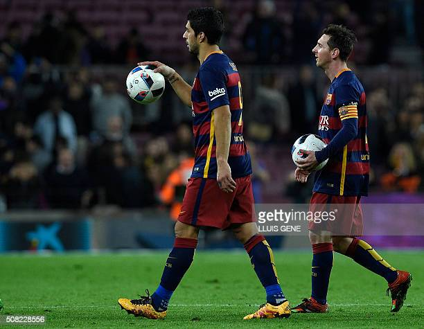 Barcelona's Uruguayan forward Luis Suarez and Barcelona's Argentinian forward Lionel Messi leave the pitch after both made it a hattrick during the...