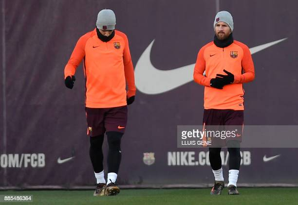 Barcelona's Uruguayan forward Luis Suarez and Barcelona's Argentinian forward Lionel Messi take part in a training session at the Sports Center FC...