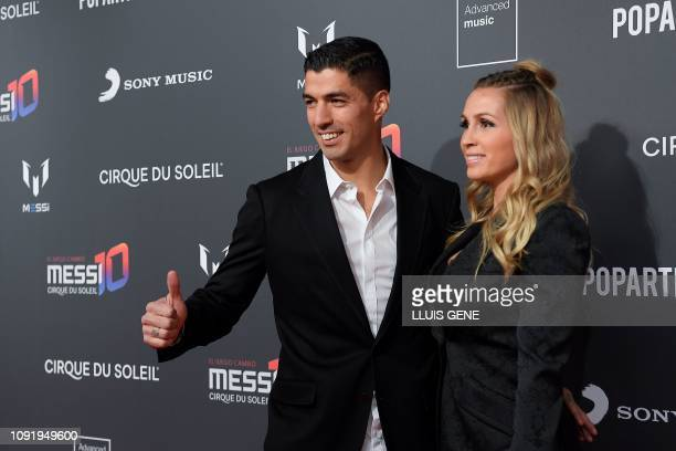 TOPSHOT Barcelona's Uruguayan forward Luis Suarez and his wife Sofia Balbi pose on the red carpet during a photocall for Cirque du Soleil's latest...