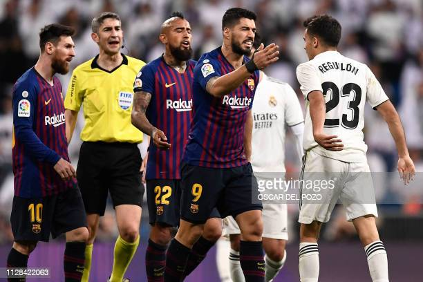 Barcelona's Uruguayan forward Luis Suarez argues with Real Madrid's Spanish defender Sergio Reguilon during the Spanish league football match between...