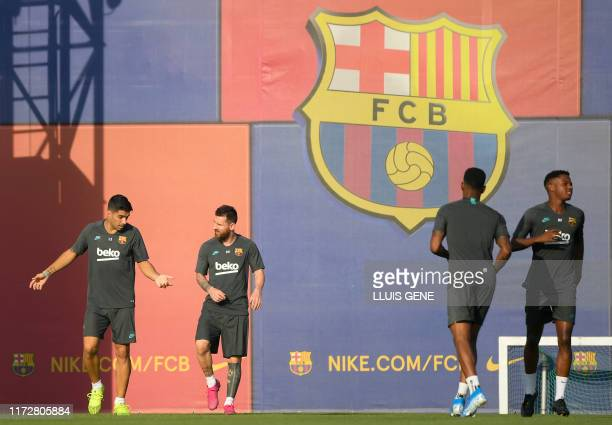 Barcelona's Uruguayan forward Luis Suarez , Barcelona's Argentine forward Lionel Messi and teammates attend a training session at the Joan Gamper...