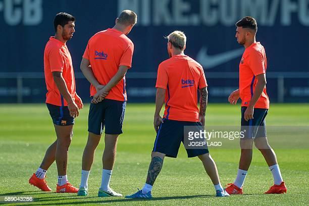 Barcelona's Uruguayan forward Luis Suarez Barcelona's defender Gerard Pique Barcelona's Argentinian forward Lionel Messi and Barcelona's forward...