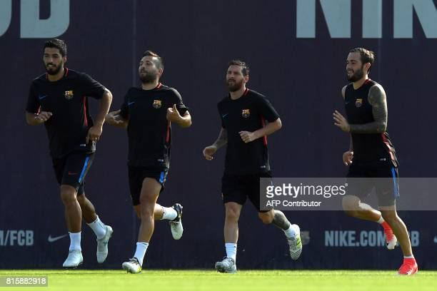 Barcelona's Uruguayan forward Luis Suarez Barcelona's defender Jordi Alba Barcelona's Argentinian forward Lionel Messi and Barcelona's defender Aleix...
