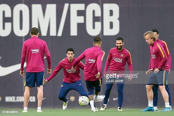 Barcelona's Uruguayan forward Luis Suarez , Barcelona's Turkish midfielder Arda Turan and Barcelona's Croatian midfielder Ivan Rakitic take part with...