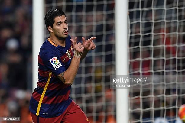 TOPSHOT Barcelona's Uruguayan forward Luis Suarez celebrates a goal during the Spanish league football match FC Barcelona vs RC Celta de Vigo at the...