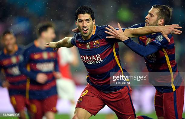Barcelona's Uruguayan forward Luis Suarez celebrates a goal during the UEFA Champions League Round of 16 second leg football match FC Barcelona vs...