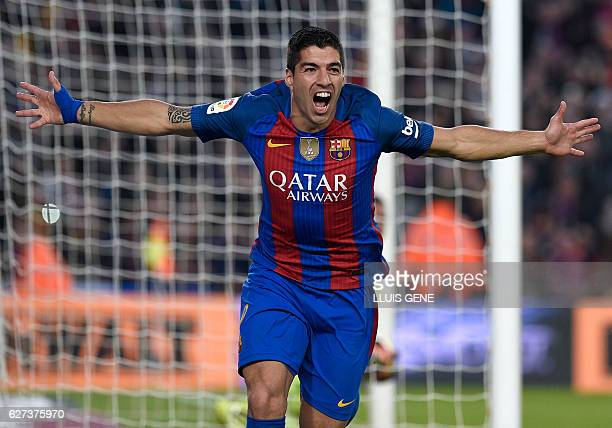 Barcelona's Uruguayan forward Luis Suarez celebrates a goal during the Spanish league football match FC Barcelona vs Real Madrid CF at the Camp Nou...