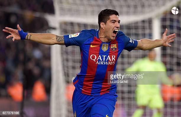 Barcelona's Uruguayan forward Luis Suarez celebrates a goal during the Spanish league football match FC Barcelona vs Real Madrid CF at the Camp Nou...