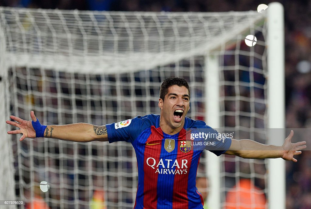 Barcelona's Uruguayan forward Luis Suarez celebrates a goal during the Spanish league football match FC Barcelona vs Real Madrid CF at the Camp Nou stadium in Barcelona on December 3, 2016. / AFP / LLUIS