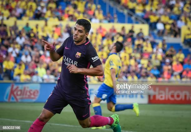Barcelona's Uruguayan forward Luis Suarez celebrates a goal during the Spanish league football match UD Las Palmas vs FC Barcelona at the Gran...