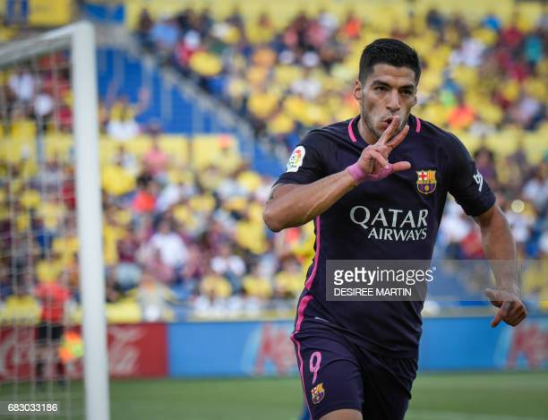 Barcelona's Uruguayan forward Luis Suarez celebrates a goal during the Spanish league football match UD Las Palmas vs FC Barcelona at the Gran...