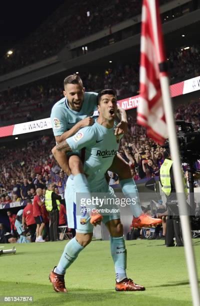 Barcelona's Uruguayan forward Luis Suarez celebrates a goal during the Spanish league football match Club Atletico de Madrid vs FC Barcelona at the...