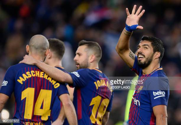 Barcelona's Uruguayan forward Luis Suarez celebrates a goal during the Spanish league football match FC Barcelona vs Levante UD at the Camp Nou...