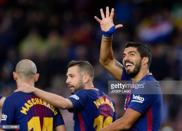 TOPSHOT Barcelona's Uruguayan forward Luis Suarez celebrates a goal during the Spanish league football match FC Barcelona vs Levante UD at the Camp...